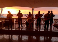 Listening to the band at sunset, Cienfuegos (Cuba)