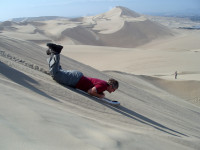 Sand boarding at the Huacachina Dunes,  Peru
