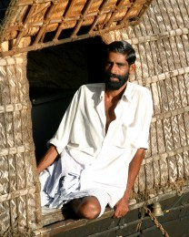 Barge crewman enjoying the late afternoon sun - Kerala